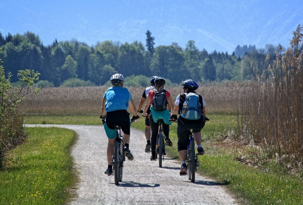 Group Of 4 People Cycling Near Their Corporate Retreat Venue